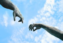 two hands, fragment of old statue. hands reaching each other with fingers against sky background. touch, contact, art minimal symbol. Creation of Adam metaphor by Michelangelo