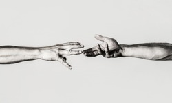 Two hands, helping arm of a friend, teamwork. Rescue, helping gesture or hands. Close up help hand. Helping hand concept, support. Helping hand outstretched, isolated arm, salvation. Black and white.