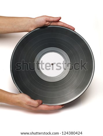 Two hands hold Vinil Record white isolated. Stock fotó ©