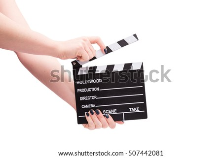Two hands holding a cinema clap isolated on white #507442081