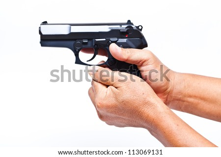 Two hands holding a gun with finger on the trigger on a white background - stock photo