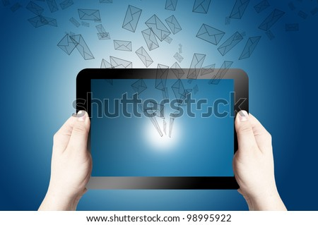 Two hands holding and point on digital tablet with 3D mail icon coming from the screen on blue background