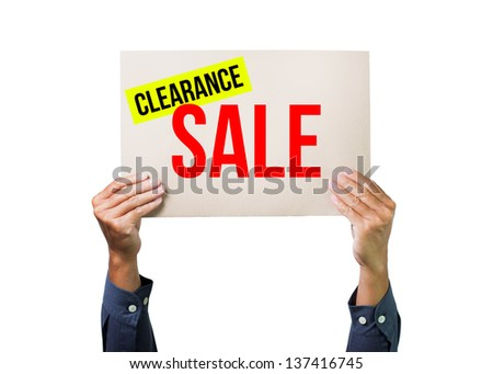 Two hands holding brown cardboard with clearance sale overhead on white background