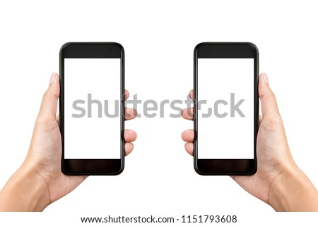 Two hands holding mobile phones on white background with empty screens for montage #1151793608