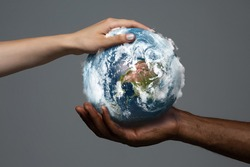 Two hands holding planet Earth, close up. Environment save, taking care of nature and ecology, supporting hands concept. Globe woldwide protection, traveling and protecting of human's home.