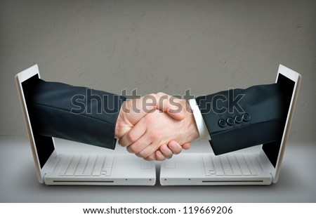 Two hands making a deal over internet