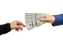 Two hands of business women make transactions. Woman giving a bunch of dollars banknotes to another person on a white background