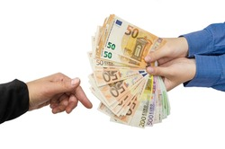 Two hands of business women make transactions. Woman giving a bunch of euro banknotes to another person on a white background .Concept of giving or taking money.