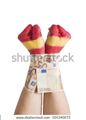 Two hands painted flag Spain and cuffed with 50 euro notes. The picture is intended to convey the concept of the spanish economic crisis exerted by banks and financial markets.