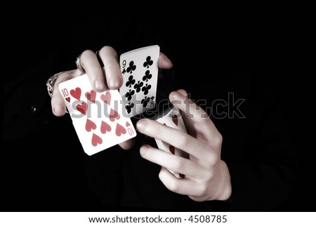 two hands playing cards