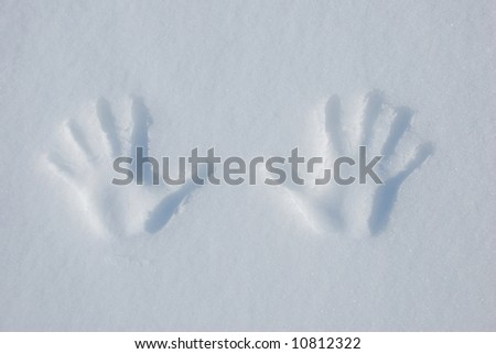 Two hands prints in the snow