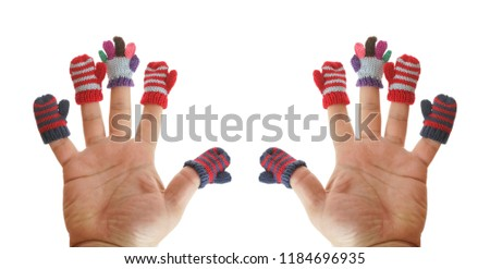 two hands. small mittens and gloves dressed on male fingers. isolated on white background. winter time season #1184696935