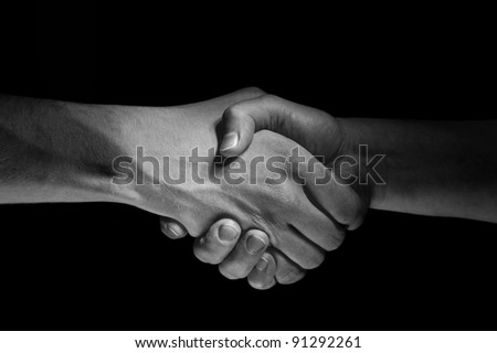 Two hands unite with eachother as deal agreement