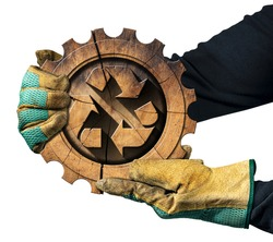 Two hands with protective work gloves showing a recycling symbol made of wood inside a cogwheel. Sustainable Resources concept. Isolated on white background.