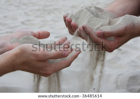 two hands with sand, symbolize comunication between two peoples
