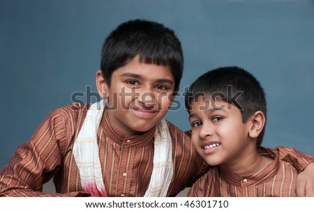 two handsome indian brothers looking happy