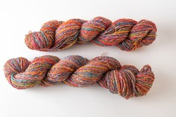 Two hanks of hand spun wool.