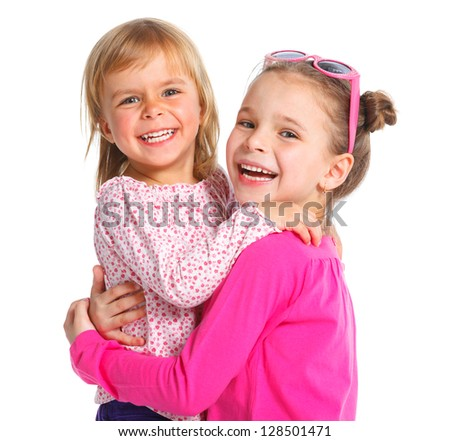 Two happy adorable smiling sisters. Isolated white background