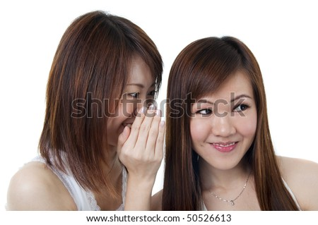 Two happy asian friends talking over white background.