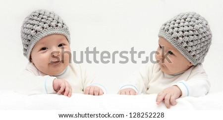 Two happy babies knitted hat