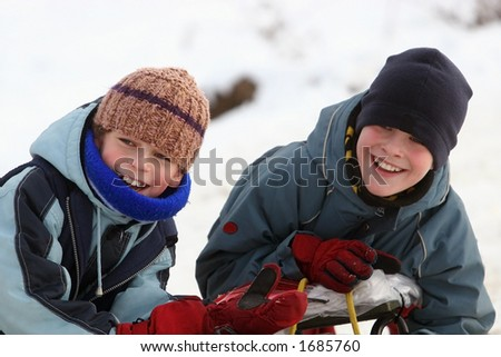 Two happy boys winter play
