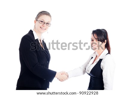 Two happy business women handshake, isolated on white background. - stock photo