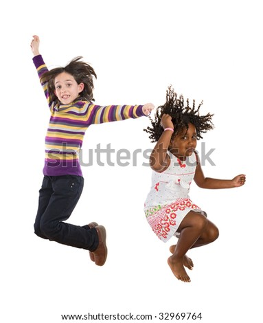 Two happy children jumping at once on a white background