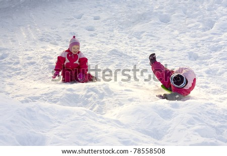 Two happy children playing in the snow