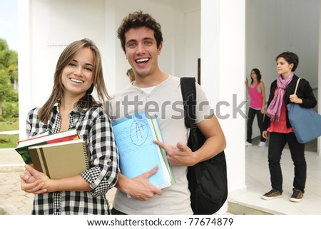 Two happy college or university students smiling