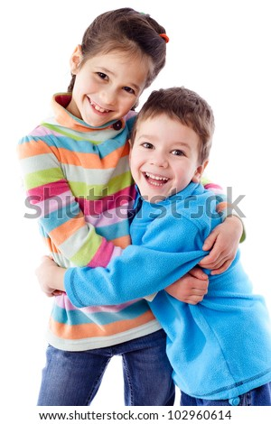 Two happy funny kids standing together and embracing, isolated on white