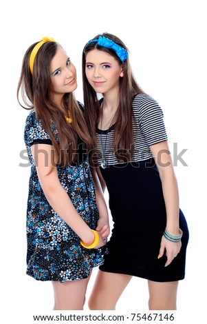 Two happy girls friends. Isolated over white background. - stock photo