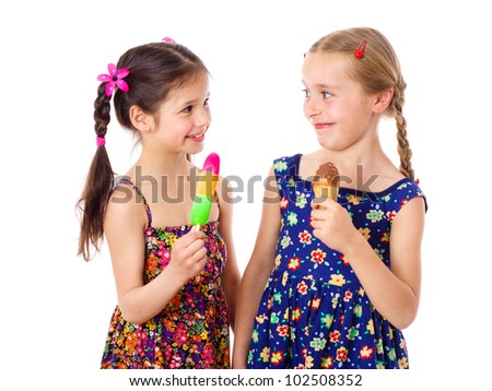 Two happy girls with ice cream, isolated on white