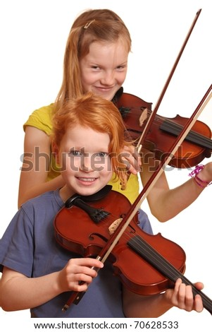 Two happy girls with violins isolated on white background