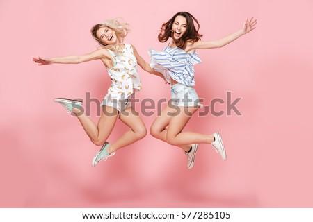 two happy joyful young women...