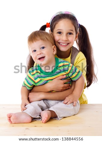 Two happy kids hugging together, isolated on white