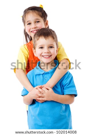 Two happy kids standing together, isolated on white