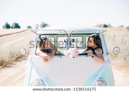 Two happy lesbian women in the old van Stockfoto ©