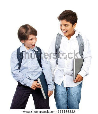 Two happy schoolboys isolated on white background, cheerful teenagers laughing, cute smiling kids holding textbooks, best friends standing in studio, back to school, education and knowledge concept