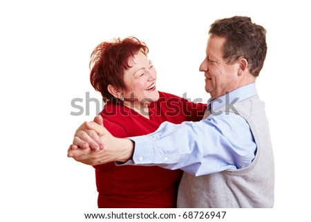 Two happy senior people dancing a waltz
