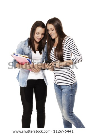 two happy teenage students looking at a smartphone on white background
