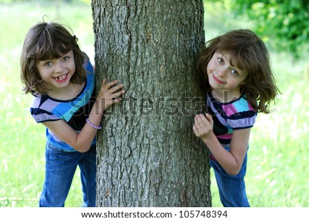 stock photo : two happy twin girls outdoors in spring