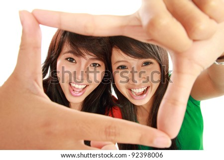two happy woman posing for a photo isolated over white background