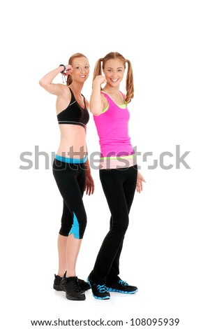 Two happy women doing fitness