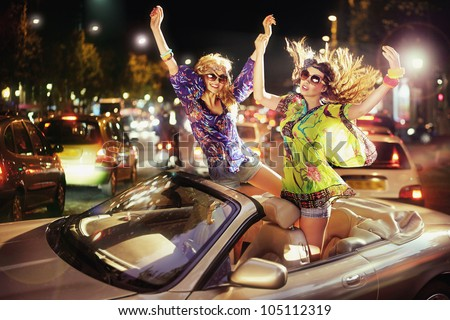 Two happy women in car
