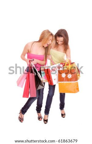 Two happy young beautiful women with the purchases - on white - stock photo