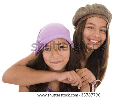 Two happy young girls isolated on white