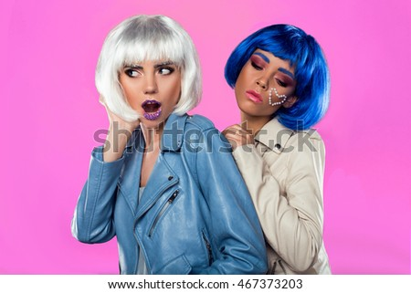 Two happy young women wearing wigs #467373203
