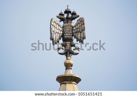 Two-headed eagle, Russian coat of arms isolated on white. Symbol of imperial Russia #1051651421