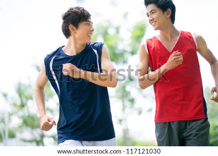 Two healthy boys jogging in the morning