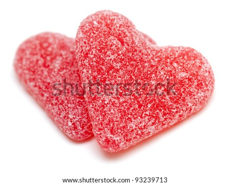 two heart-shaped candies isolated on white background
